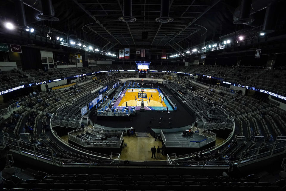 Villanova plays Winthrop in the second half of a first round game in the NCAA men's college basketball tournament at Farmers Coliseum in Indianapolis, Friday, March 19, 2021. Restrictions due to the COVID-19 pandemic have limited crowds, reduced interactions and created an abnormal NCAA experience for those involved. It's sacrifices they've all been asked to make by the NCAA to pull off a tournament in the midst of the ongoing pandemic. (AP Photo/Michael Conroy)
