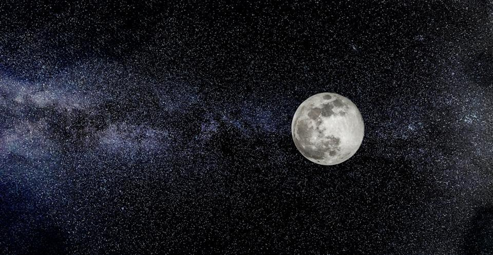 Scene with full moon and stars in the background. (Photo: IonelV via Getty Images)