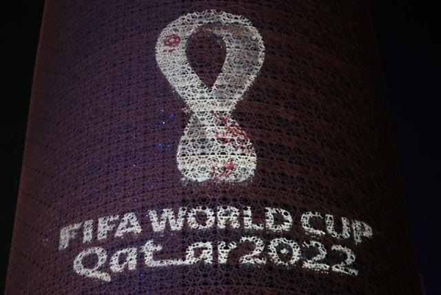 FILE PHOTO: The tournament's official logo for the 2022 Qatar World Cup is seen on the Doha Tower, in Doha