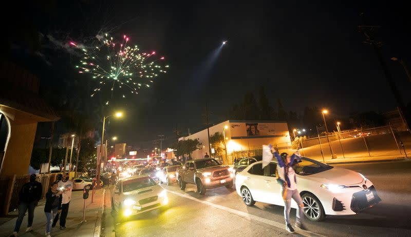 People celebrate Los Angeles Dodgers' victory at the end of game 6 of the 2020 World Series between Los Angeles Dodgers and Tampa Bay Rays, amidst the outbreak of the coronavirus disease (COVID-19), in Los Angeles
