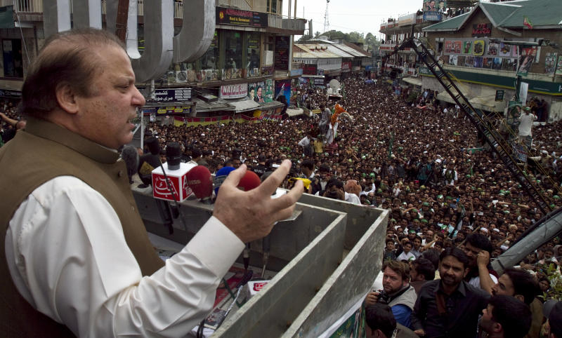 In this Sunday, April 28, 2013 photo, Pakistan's former Prime Minister and leader of the Pakistan Muslim League Nawaz Sharif speaks during an election rally in Murree, Pakistan. Sharif has criticized the outgoing Pakistan People's Party for selling out the country's sovereignty in exchange for U.S. aid and likes to recount how he tested Pakistan's first nuclear weapon in 1998 despite American pressure. (AP Photo/Anjum Naveed)