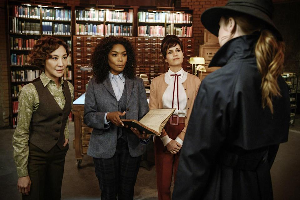 from left is Michelle Yeoh, Angela Bassett, Carla Gugino, and Karen Gillan in a library