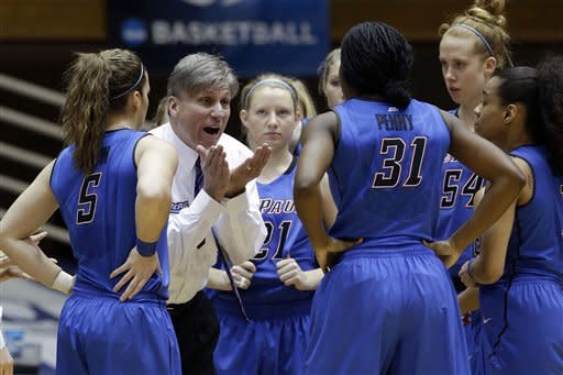 DePaul coach Doug Bruno, second from left, speaks with his team during a time out during the first half of a first-round game against Oklahoma State in the women's NCAA college basketball tournament in Durham, N.C., Sunday, March 24, 2013. (AP Photo/Gerry Broome)
