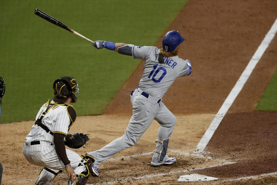 The Dodgers' Justin Turner connects for a solo home run in the ninth inning April 17, 2021.