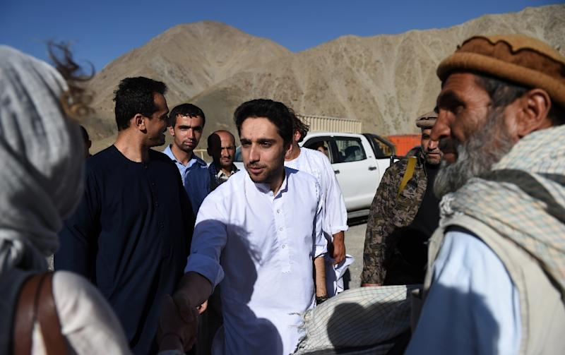 Ahmad Massoud, the son of the late Afghan military and political leader Ahmad Shah Massoud, meets supporters at the tomb of his late father at Saricha in Panjshir province on July 19, 2016 (AFP Photo/Wakil Kohsar)