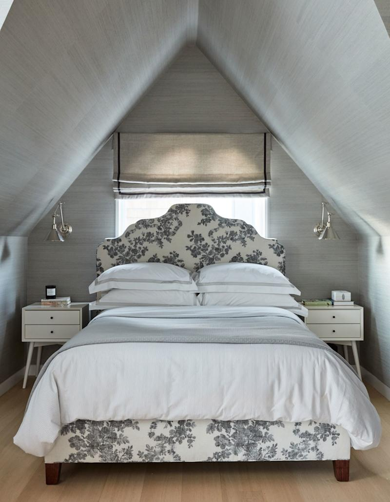 Catherine Kwong installed sconces above the nightstands in this San Francisco bedroom.