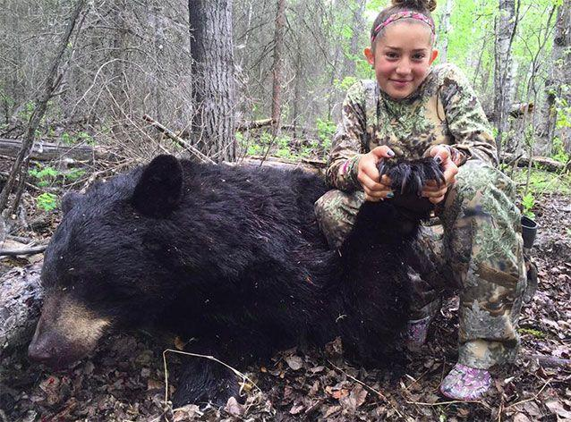 The youngster, proudly showing off her kill of a wild bear, says she will never back down from hunting despite the backlash. Picture: Facebook