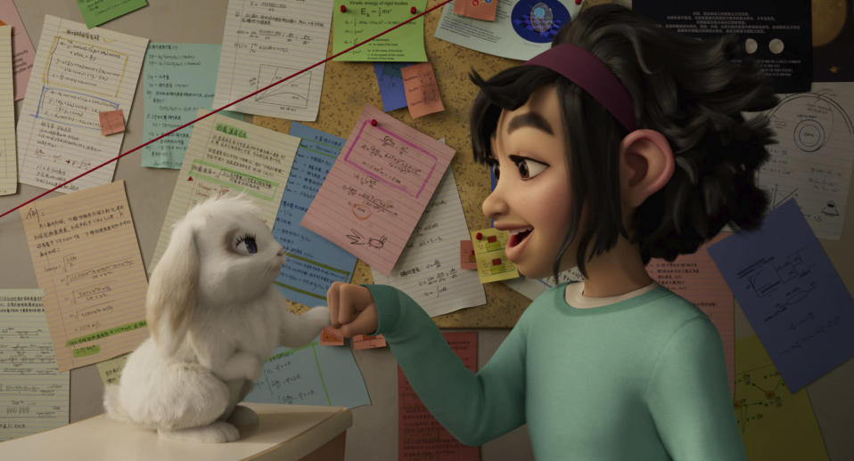 "This image released by Netflix shows characters Bungee the rabbit, left, and Fei Fei, voiced by Cathy Ang, in a scene from ""Over the Moon."" (Netflix via AP)"