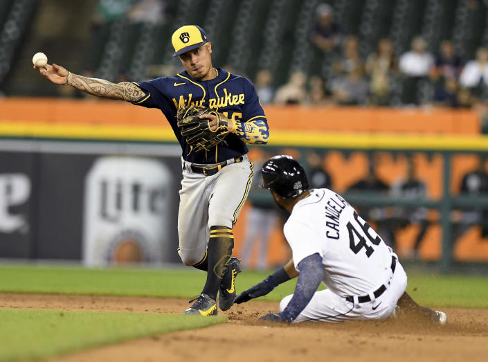 Milwaukee Brewers second baseman Kelton Wong throws to first after forcing out Detroit Tigers' Jeimer Candelario on a double play hit into by Eric Haase during the fifth inning of a baseball game in Detroit, Tuesday, Sept. 14, 2021. (AP Photo/Lon Horwedel)