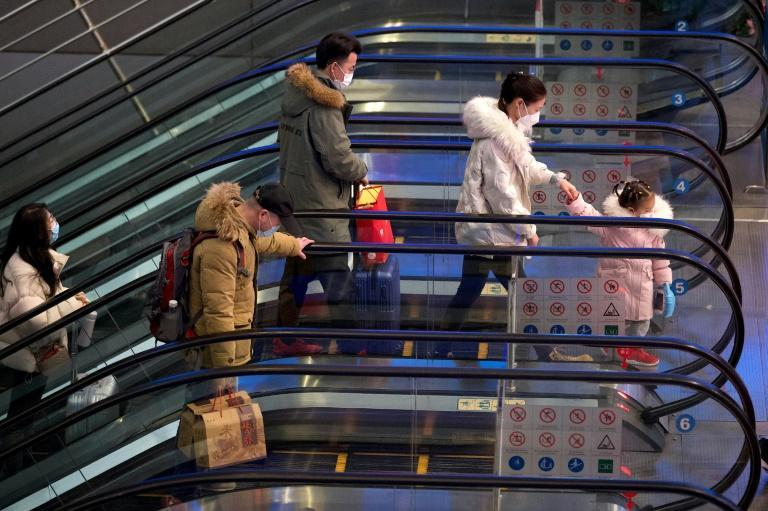 As China offers a slew of financial incentives to workers who stay put, railway stations in Beijing and elsewhere are emptier than usual
