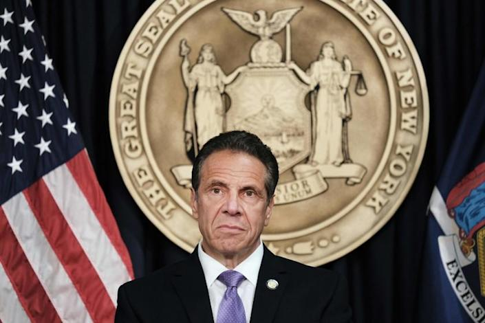 New York Governor Andrew Cuomo speaks to the media at a news conference in Manhattan on May 5, 2021 in New York City. - Cuomo has announced that Broadway will reopen on September 14, with some tickets going on sale beginning tomorrow. Theaters, a popular draw for tourists, will be open at 100 percent capacity, the governor says. Cuomo has also announced that visitors to both Yankee and Mets baseball games will soon be able to receive a vaccination at the ball field and in return will get a free ticket to another game. (Photo by Spencer Platt / POOL / AFP) (Photo by SPENCER PLATT/POOL/AFP via Getty Images)