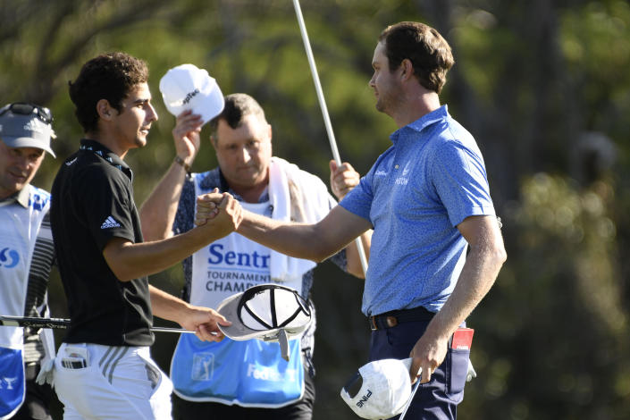 Champion Harris English, right, greets runner up Joaquin Niemann after the final round of the Tournament of Champions golf event, Sunday, Jan. 10, 2021, at Kapalua Plantation Course in Kapalua, Hawaii. (Matthew Thayer/The Maui News via AP)