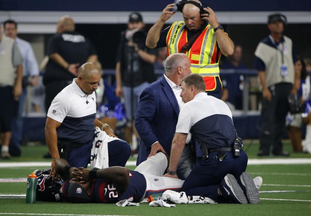 Houston Texans staff check on running back Lamar Miller (26) after he suffered an unknown injury in the first half of a preseason NFL football game against the Dallas Cowboys in Arlington, Texas, Saturday, Aug. 24, 2019. (AP Photo/Michael Ainsworth)