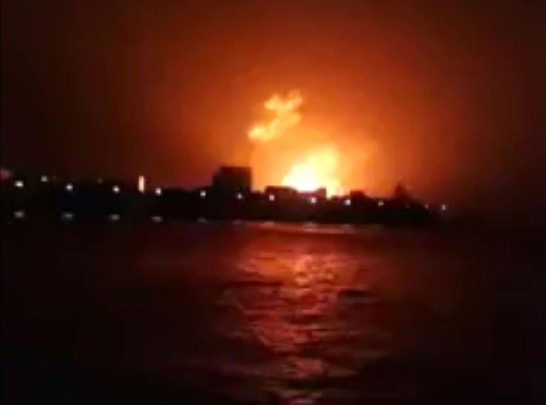 """This frame grab taken from video footage provided by Indian broadcaster NWS early on August 14, 2013, shows a fire at the Indian Naval Dockyard in Mumbai. Indian divers and engineers have struggled to refloat a submarine that exploded with 18 crewmen on board, as the prime minister voiced """"deep regret"""" at the blast which is feared to have left no survivors"""