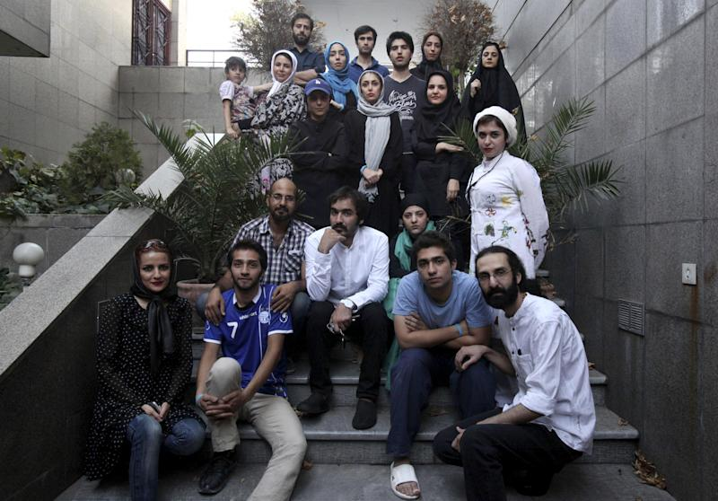 "Iranian theater director Amin Miri, third from left in second row, poses with his theater group prior to their performance of ""The Blue Feeling of Death,'' outside the theater hall in Arasbaran Cultural Center in Tehran, Iran, Thursday, July 18, 2013. The production opened last month as a showcase of activist art against Iran's legal codes that allow death sentences for children _ who then wait until their 18th birthday for possible execution. Opening night came even as Iranian officials tightened controls on the social media and other forms of political opposition before presidential elections, whose centrist winner, Hasan Rouhani, has brought hope of reversing some of the crackdowns. (AP Photo/Vahid Salemi)"