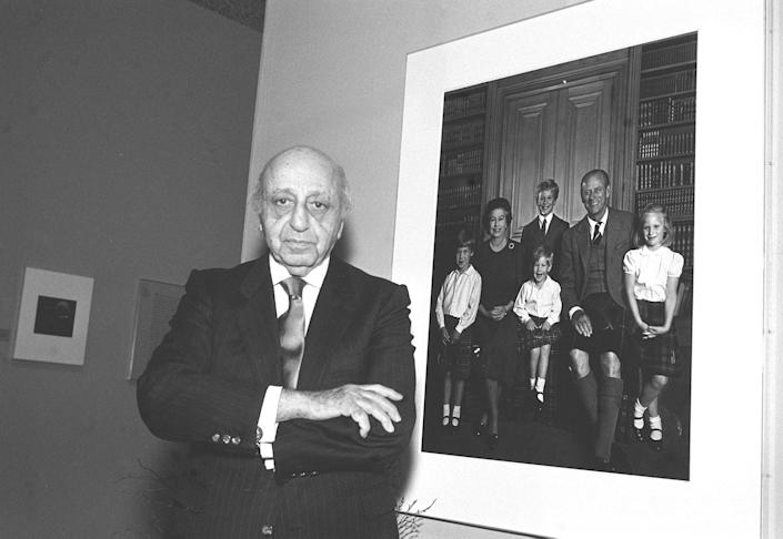 Yousuf Karsh with his royal family portrait