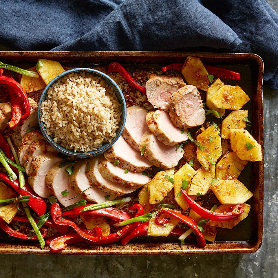 "<p>Take your guests on a culinary trip to the islands with this Hawaiian-inspired pork recipe. The tenderloin is roasted with pineapples, sweet peppers and onion in a mouthwatering sauce flavored with soy, lime juice and ginger. Add a bit of fresh cilantro to each serving and you'll be eating like the island locals! <a href=""http://www.eatingwell.com/recipe/266590/hawaiian-pork/"" rel=""nofollow noopener"" target=""_blank"" data-ylk=""slk:View recipe"" class=""link rapid-noclick-resp""> View recipe </a></p>"