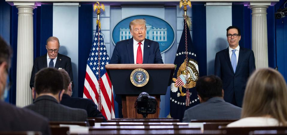 US President Donald Trump, with Director of the National Economic Council Larry Kudlow (L) and US Secretary of the Treasury Steven Mnuchin, speaks to the press in the Brady Briefing Room of the White House in Washington, DC, on July 2, 2020. (Photo by JIM WATSON / AFP) (Photo by JIM WATSON/AFP via Getty Images)