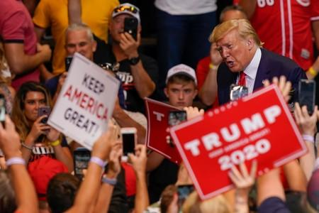 U.S. President Donald Trump acknowledges supporters as he departs a campaign rally in Cincinnati
