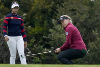 Brooke Henderson, of Canada, reacts as her putt drops in the cup on the first green as Patty Tavatanakit, of Thailand, left, looks on during the first round of the U.S. Women's Open golf tournament at The Olympic Club, Thursday, June 3, 2021, in San Francisco. (AP Photo/Jeff Chiu)