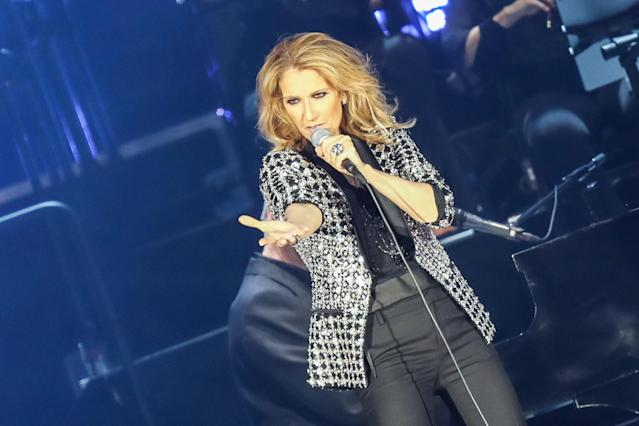 Céline Dion, performing in Nice, France, in July, reaches out to her late husband prior to every performance. (Photo: Tony Barson/Getty Images)