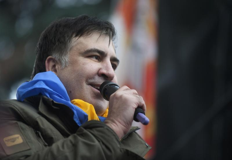 """Former Georgian president Mikheil Saakashvili addresses protesters after he escaped with help from supporters and led them on a march toward parliament, where they planned to call for President Petro Poroshenko to resign in Kiev, Ukraine, Tuesday, Dec. 5, 2017. Some hundreds of protesters chanting """"Kiev, rise up!"""" blocked Ukrainian police as they tried to arrest Saakashvili on Tuesday, who escaped and led supporters on a march toward parliament but was later detained. (AP Photo/Evgeniy Maloletka)"""