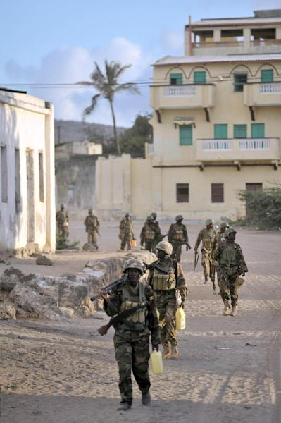 Soldiers belonging to the African Union Mission in Somalia, walking through the al-Shabab stronghold of Barawe, Somalia (AFP Photo/Tobin Jones)