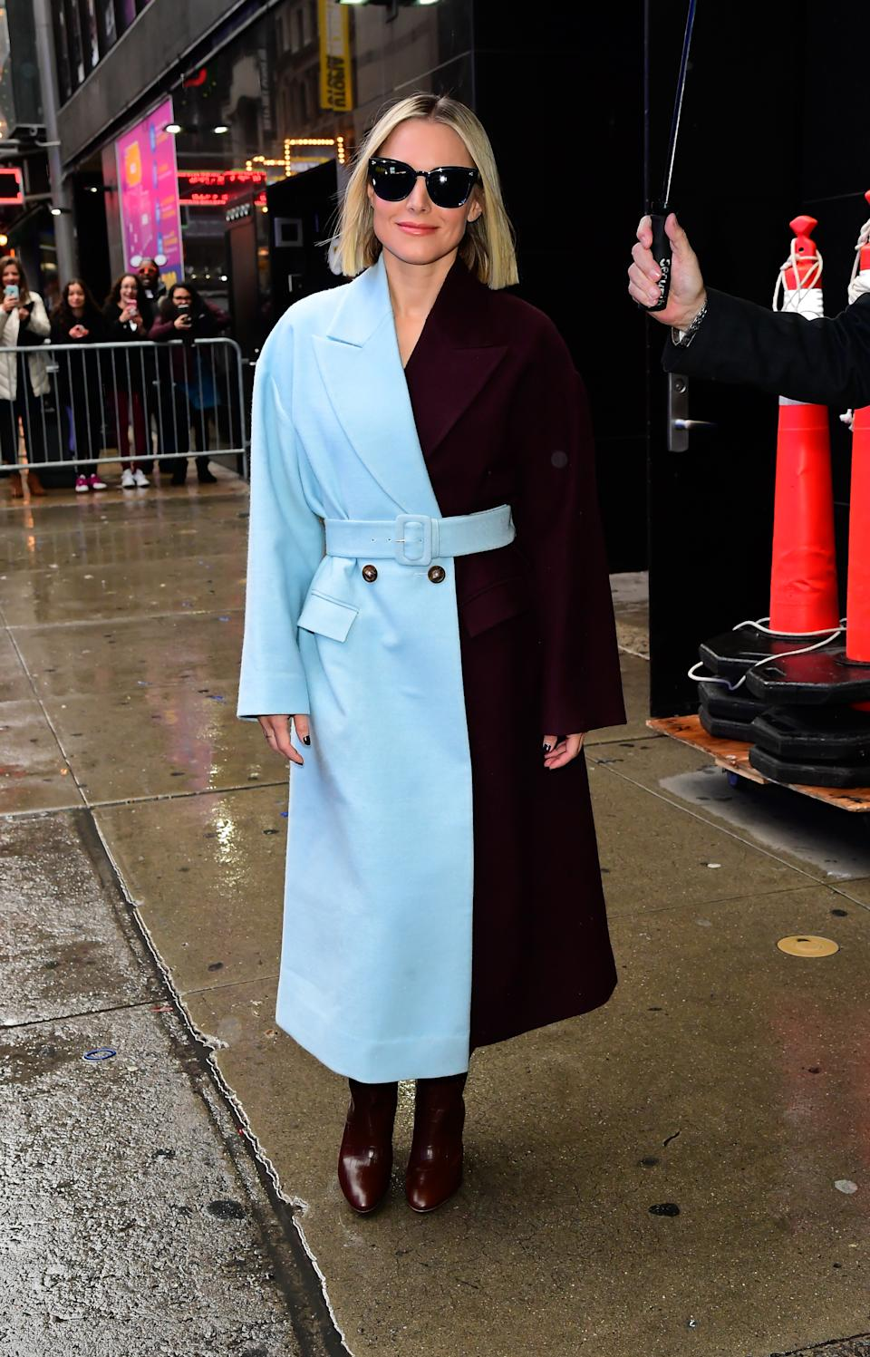 Kristen Bell wears a Bouguessa coat. (Credit: Getty Images)