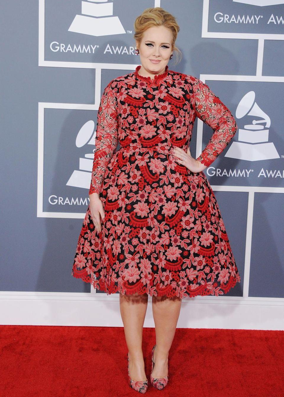 <p>For the 2013 Grammy Awards, Adele opted for this ladylike Valentino design, featuring pink and red floral lace. </p>