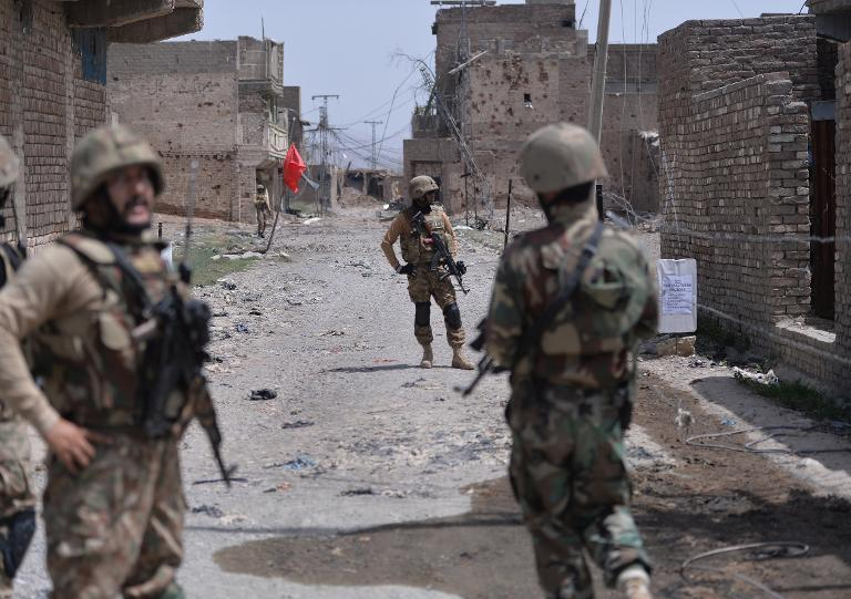 Pakistani soldiers patrol a town during a military operation against Taliban militants in North Waziristan, on July 9, 2014