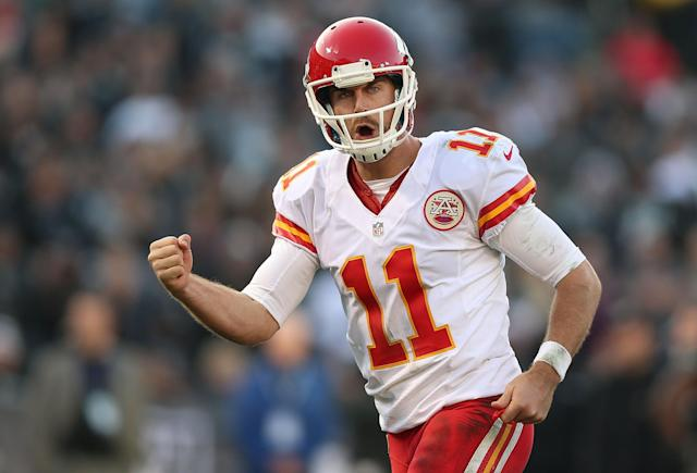 OAKLAND, CA - DECEMBER 15: Alex Smith #11 of the Kansas City Chiefs celebrates after a touchdown against the Oakland Raiders at O.co Coliseum on December 15, 2013 in Oakland, California. (Photo by Jed Jacobsohn/Getty Images)