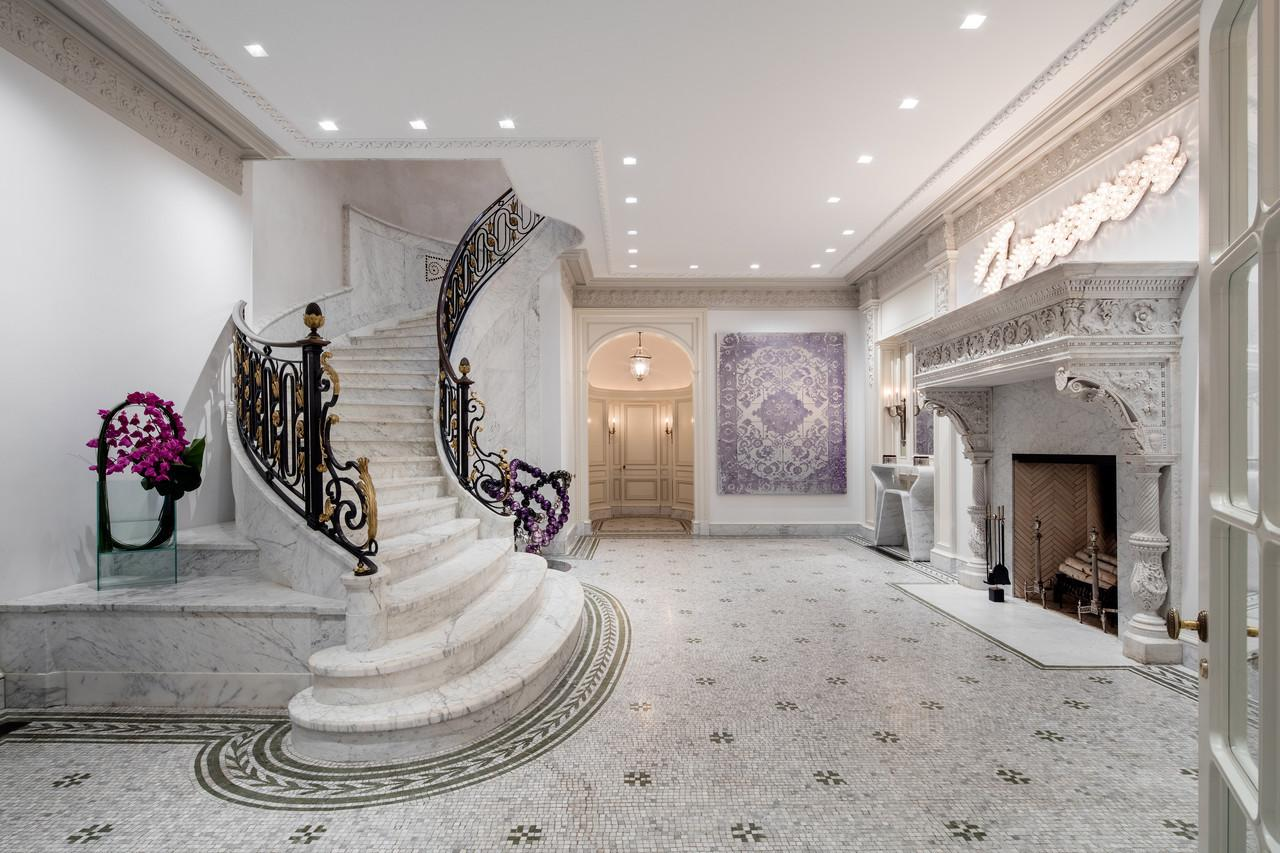 """<p>The entry hall's original marble and malachite floor was found during renovations, <a href=""""http://bit.ly/1odDLHd"""">according to Architectural Digest</a>. See the next photo. (<a href=""""http://bit.ly/1odK65B"""">Photo by Evan Joseph via the Modlin Group property listing</a>)</p>"""