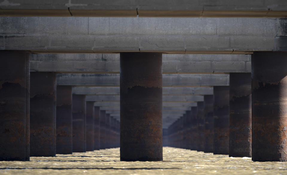 FILE - In this July 29, 2021 file photo, the pillars of the massive Rosario-Victoria Bridge are exposed during a drought affecting the Parana River near Rosario, Argentina. At the port city of Santa Fe the river registered a level of 22 centimeters, the lowest in 50 years. (AP Photo/Victor Caivano, File)
