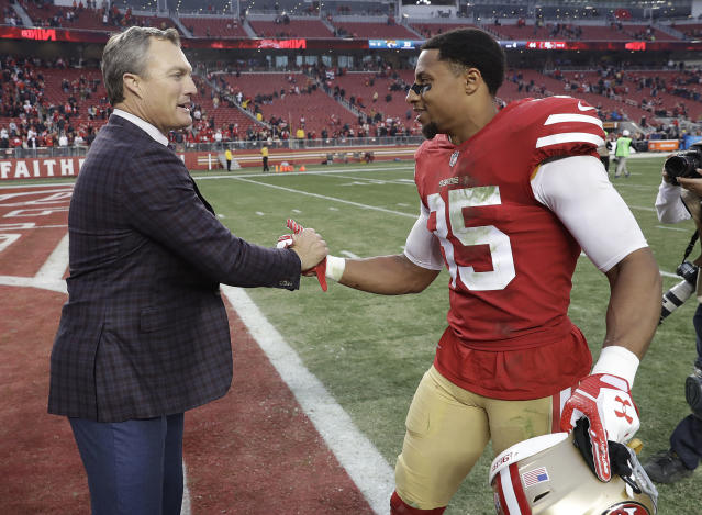 Eric Reid, sharing a moment with 49ers general manager John Lynch, is still on the free-agent market. (AP)