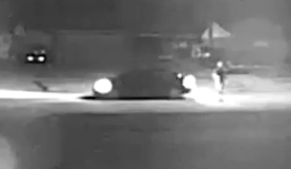Image from video of car and people outside Gloria's home.