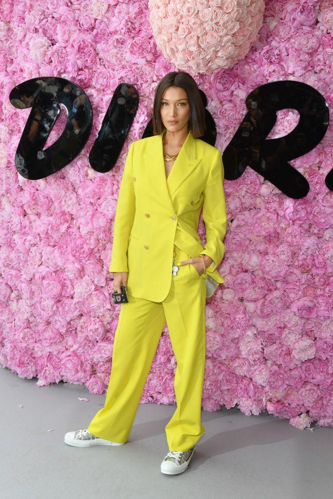 <p>Bella wore neon to the Dior Homme Menswear Spring/Summer 2019 show.</p>