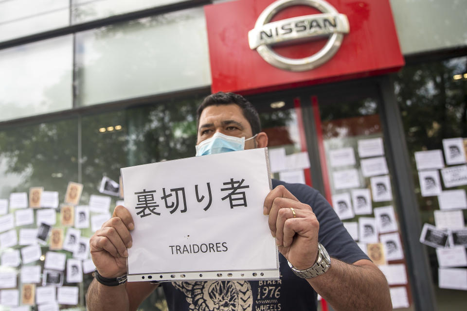 Workers and relatives of the car company NISSAN gather in front of several multinational vehicle shops to protest against the closure of the three plants in Barcelona that could send more than 23,000 people unemployed between direct and indirect work during the Coronavirus - Covid-19 crisis in Barcelona, Catalonia, Spain, on May 29, 2020.  (Photo by Albert Llop/NurPhoto via Getty Images)