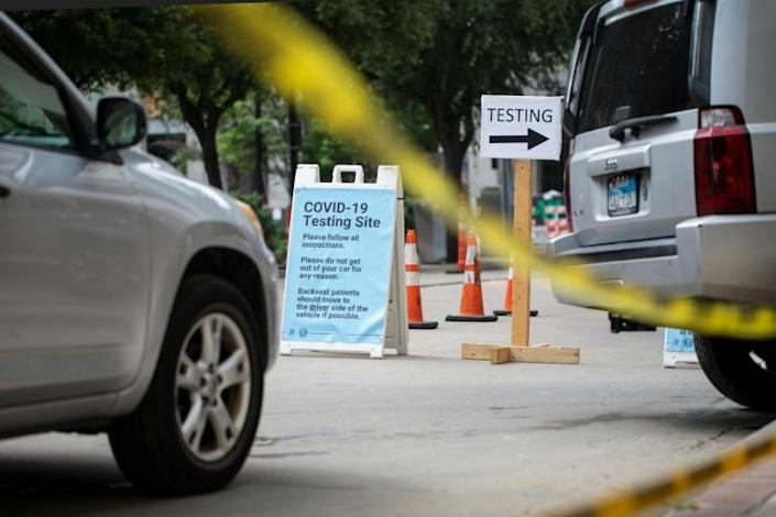 Cars wait in line at a drive up COVID-19 testing site in Dallas, Texas a state facing a surge of new cases after the government allowed business to open prematurely (AFP Photo/Montinique Monroe)