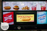 """<p>The couple was most excited about the evening's send-off — a <a href=""""https://www.sonicdrivein.com/"""" rel=""""nofollow noopener"""" target=""""_blank"""" data-ylk=""""slk:Sonic Drive-In"""" class=""""link rapid-noclick-resp"""">Sonic Drive-In</a> pop-up serving everything from """"put a ring on it"""" onion rings to Nashville hot chicken sliders to the couple's personal concoction, the Bobby Water.</p> <p>(Despite the name, the drink — which features water, strawberries, cherries and Nerds — was Parker's creation. """"Bobby went on air the next day and was like, 'So I invented this crazy thing at Sonic.' And I caught wind of it and was furious!"""" she recalls with a laugh. """"That might be the biggest fight we've ever had."""")</p>"""