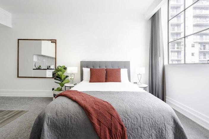 """<p>In addition to cleaning your linens, make sure you're <a href=""""https://www.thespruce.com/clean-your-mattress-the-natural-way-350742"""" rel=""""nofollow noopener"""" target=""""_blank"""" data-ylk=""""slk:giving your mattress a good cleaning"""" class=""""link rapid-noclick-resp"""">giving your mattress a good cleaning</a> a few times a year. Once you strip off your bedding, The Spruce recommends vacuuming the top, sides, and underside of your mattress. Then, mix one cup of baking soda with a few drops of lavender essential oil in a bowl and shake the fragranced baking soda evenly over the entire mattress through a strainer. Leave on for a few hours before vacuuming the baking soda off the mattress.</p><p>You can also remove any stains on the mattress by mixing a paste of baking soda, salt, and water. Rub the stain with the paste, let it sit for 30 minutes, and then wipe away with a damp clean cloth.</p>"""