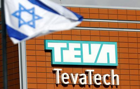 An Israeli flag flutters near the logo of Teva Tech which is part of Teva Pharmaceutical Industries in Neot Hovav, southern Israel December 14, 2017. REUTERS/Amir Cohen