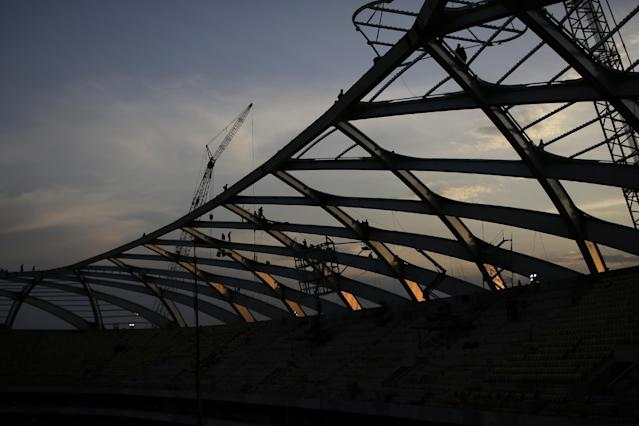 In this Dec.10, 2013 photo, construction workers works on the roof of the Arena da Amazonia stadium, in Manaus, Brazil. A construction worker fell to his death Saturday while working on the roof of a World Cup stadium marking the third fatality at a tournament building site in less than a month. The construction company building the Arena Amazonia said Marcleudo de Melo Ferreira fell some 115 feet in the early morning accident. (AP Photo/Renata Brito)