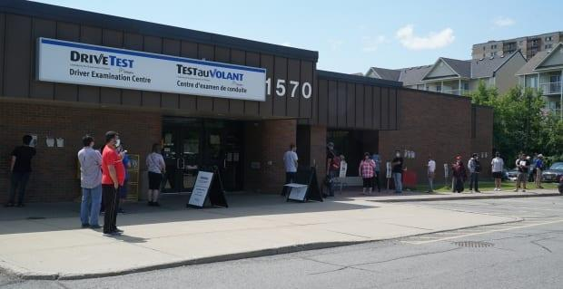 A long line can be seen outside the DriveTest examination centre on Walkley Road in Ottawa last week. (Matthew Kupfer/CBC - image credit)