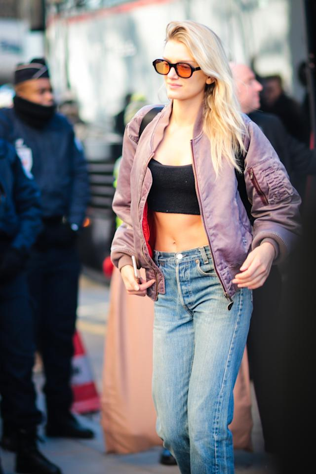 <p>Lily Donaldson flashed her abs in a short crop top and purple satin bomber jacket. <em>(Photo: Getty Images)</em> </p>