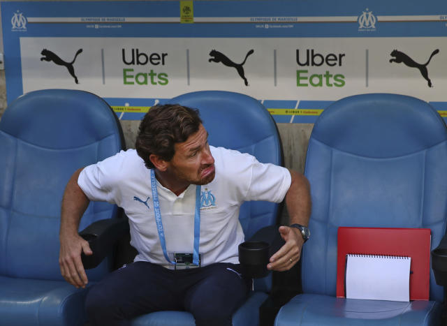 Marseille's head coach Andre Villas-Boas takes his seat on the bench before the French League One soccer match between Marseille and Reims at the Velodrome Stadium in Marseille, France, Saturday, Aug. 10, 2019. (AP Photo/Daniel Cole)