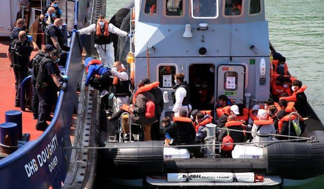 A group of people thought to be migrants are brought in to Dover, Kent, following a small boat incident in the Channel