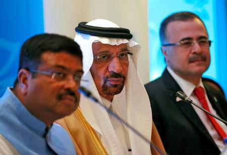 Saudi Energy Minister Khalid al-Falih addresses the media flanked by India's FILE PHOTO: Oil Minister Dharmendra Pradhan (L) and Saudi Aramco Chief Executive Officer Amin Nasser (R) during International Energy Forum (IEF) to announce Saudi Aramco's participation in the planned refinery project in western state of Maharashtra, in New Delhi, India, April 11, 2018. REUTERS/Altaf Hussain