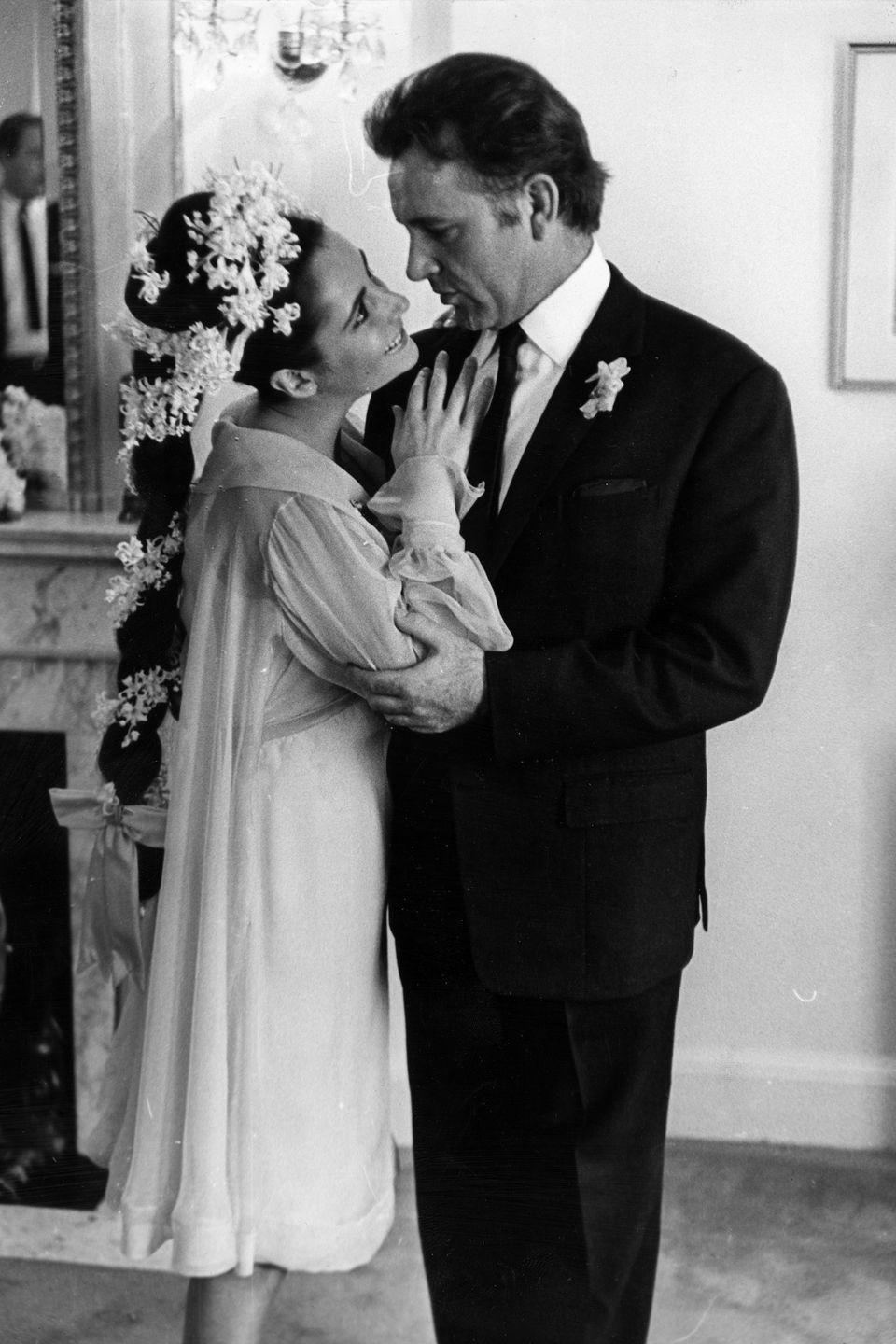 <p>After garnering plenty of media attention for their brazen affair while filming <em>Cleopatra</em> in Rome, Elizabeth Taylor married Richard Burton in a yellow chiffon dress and flower adorned braid at The Ritz-Carlton in Montreal. </p>