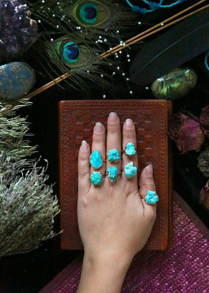 """<h2>December: Turquoise</h2><br>Use turquoise to bring on luck — especially in <a href=""""https://www.refinery29.com/en-us/sad-romantic-movies-that-make-you-cry"""" rel=""""nofollow noopener"""" target=""""_blank"""" data-ylk=""""slk:your romantic life"""" class=""""link rapid-noclick-resp"""">your romantic life</a>. """"Turquoise has always been regarded as a symbol of protection, success, and good fortune,"""" says Montúfar. """"Some even use it to attract charm and therefore… love. As a vessel of feminine energy, it also contains anti-inflammatory and detoxifying effects."""" <br><br><strong>FormaJewelry</strong> Turquoise Raw Ring, $, available at <a href=""""https://www.etsy.com/listing/564436940/turquoise-raw-ring-raw-stone-ring-raw"""" rel=""""nofollow noopener"""" target=""""_blank"""" data-ylk=""""slk:Etsy"""" class=""""link rapid-noclick-resp"""">Etsy</a>"""