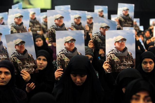 <p>Women carry pictures of Hezbollah commander Mustafa Badreddine, who was killed in an attack in Syria, during a ceremony marking a year after his death in Beirut's southern suburbs, Lebanon May 11, 2017. (Photo: Aziz Taher/Reuters) </p>